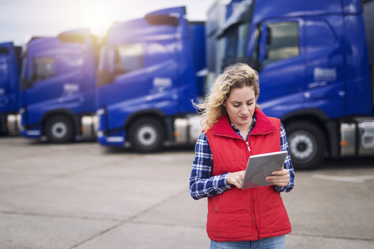 lady holding ipad in trucking